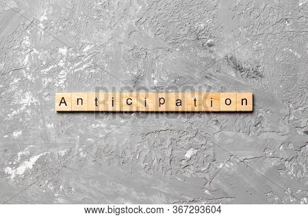 Anticipation Word Written On Wood Block. Anticipation Text On Cement Table For Your Desing, Concept