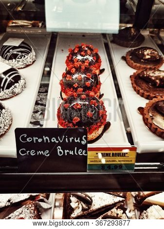 Funny Coronavirus Creme Brulee Cakes Desserts In Shop Window. Humour Art Creativity During Covid-19