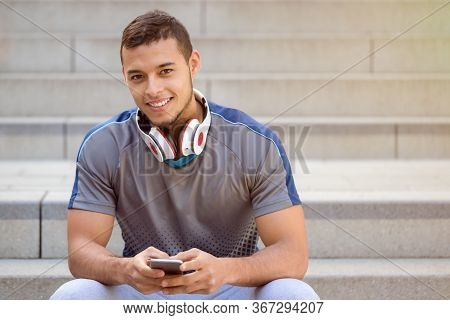 Listening To Music Young Latin Man Listen Headphones Smiling Copyspace Copy Space