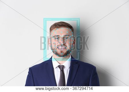 Facial Recognition System. Young Man With Scanner Frame And Digital Biometric Grid On White Backgrou