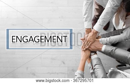 Engagement Concept. People Holding Hands Together, Top View