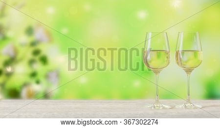 White Wine On Light Green Background. Two Wineglasses Of Vino Verde. Seasonal Holidays Concept.