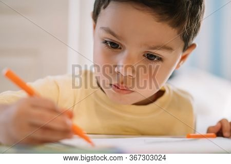 Selective Focus Of Adorable, Concentrated Boy Drawing With Felt Pen