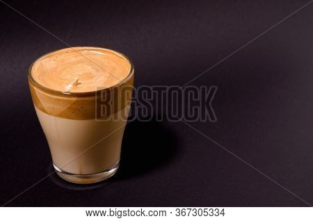 Dalgon Coffee In A Transparent Glass On A Dark Background. Milk And Whipped Coffee Foam With Sugar O