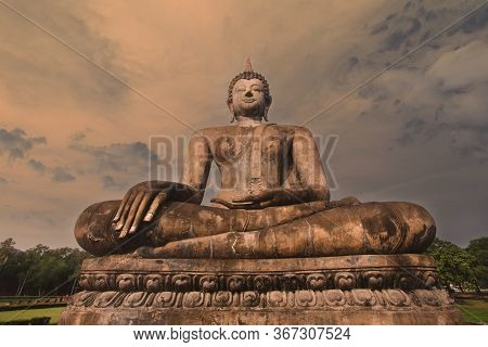 The Large Old Buddha Statue Enshrined Stands Majestically In The Sukhothai Historical Park. Amid The