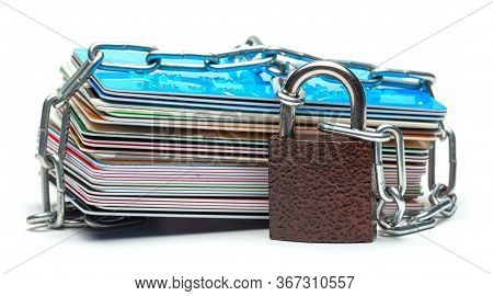 Stack Of Credit Cards And A Padlock With Chain Isolated On A White Background. Closed Access To Cred