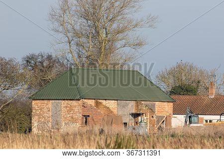 Barn Conversion Project, Renovation Of Farm Building In Progress. Rural Brick Built Barn Outbuilding