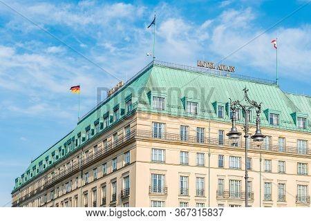 Berlin, Germany - July 28, 2019: The Famous Hotel Adlon Kempinski In Unter Den Linden Street And Par