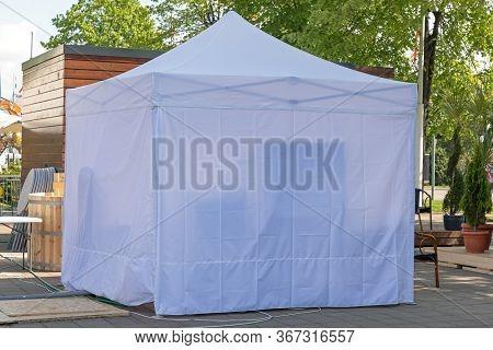 White Canopy Gazebo Tent At Garden Patio