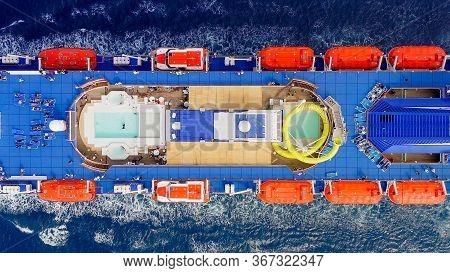 Large Cruise Ship Roaring Across The Open Sea.