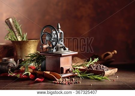 Vintage Pepper Mill With Various Peppers And Spices. Old Pepper Mill With Kitchen Utensils, Spices A