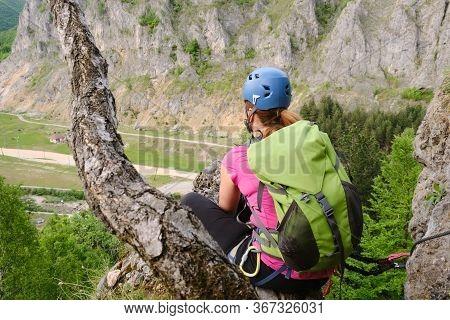 Woman High Up On A Via Ferrata Route Called Spirala Mare In Baia De Fier, Gorj County, Romania, Gaze