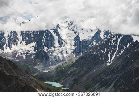 Atmospheric Alpine Landscape With Massive Hanging Glacier On Giant Rocks And Valley With Mountain La