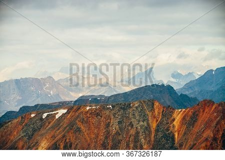 Atmospheric Alpine Landscape With Red Rockies In Golden Hour. Scenic View To Big Orange Rocks And Gi