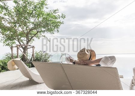 Relaxation Holiday Vacation Of Businessman Take It Easy Happily Resting On Beach Chair At Swimming P