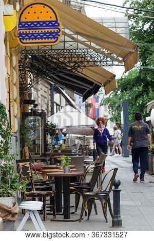 BELGRADE, SERBIA May 19 2020  street view of empty  open-air  cafe restaurant downtown in Belgrade Eastern Europe after  state of emergency cancelled due to COVID-19 virus
