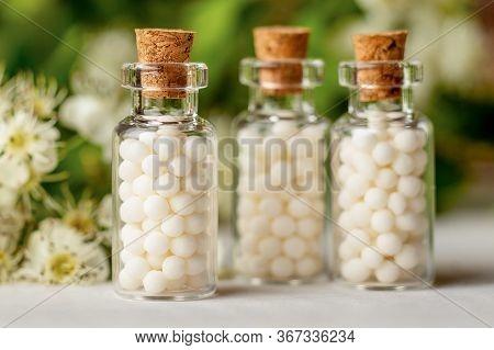 Homeopathy Globules In Bottles. Homeopathy, Naturopathy And Alternative Medicine. Alternative Homeop