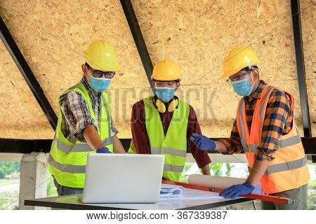 Team Of Construction Engineers And Three Architects Are Ready To Wear Medical Masks. Coronavirus Or