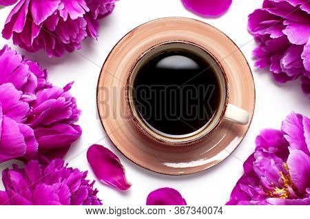 Cup Of Black Coffee And Beautiful Flowers Peonies On White Background Top View. Morning Coffee, Fema