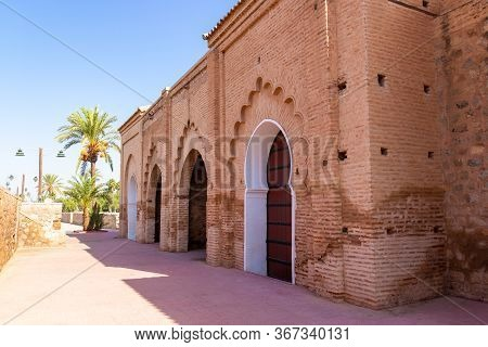 Part Of The Wall Of The Kutubiyya Mosque Decorated With Arches And Gates, Marrakesh, Morocco.