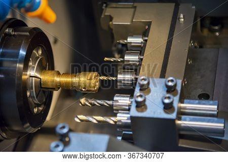 The  Multi-tasking Cnc Lathe Machine Swiss Type Tapping At The Brass  Shaft . The Hi-technology Meta