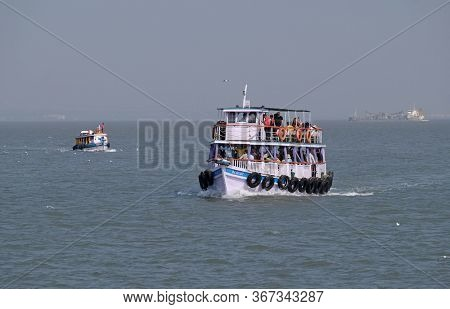 MUMBAI, INDIA - FEBRUARY 15, 2020: Boat trip from gateway of India to Elephanta Caves, Mumbai, India