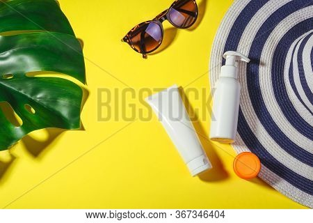 Sunscreen. Hat With Sunglasses And Protection Cream Spf Flat Lay On Yellow Background. Beach Accesso