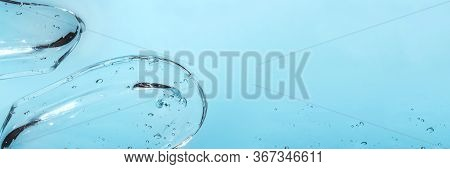 Texture Of Hyaluronic Acid, Serum Gel. Transparent Smear Of Gel Isolated On White Background Banner