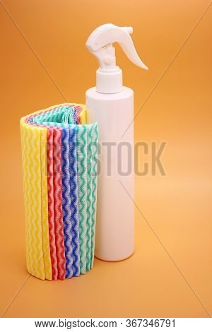 White Bottle And Multicolored Cleaning Cloths. Cleanliness And Disinfection. Antiseptic, Cleaning Ag