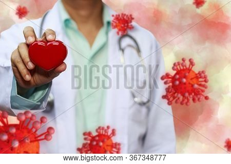 Doctor Hold Red Heart With Concept Model Covid 19 Or Coronavirus Case Of Respiratory Epidemic Or Dam
