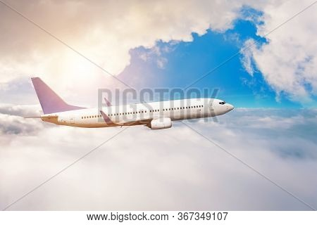 The Plane Flies In Layers Of Dense White Clouds And Bright Sun