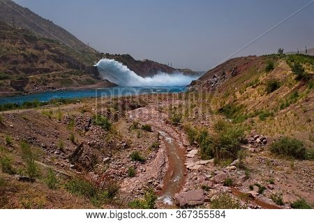 Tajikistan, Spectacular Discharge Of Excess Water At The Nurek Hpp On The Vakhsh River. The Height O
