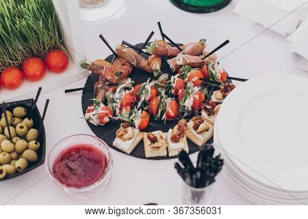 Delicious Appetizer And Canape On Table At Wedding Reception In Restaurant. Luxury Catering Service.