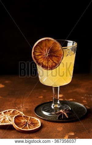 Classic Cocktail Glass With Alcohol Cocktail Orange Sparkling Drink, Close-up. Modern Alcoholic Beve
