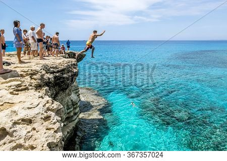 Cape Greco.cyprus.21 May 2016. Man Jumps Into Sea From A Cliff At Cape Greco .
