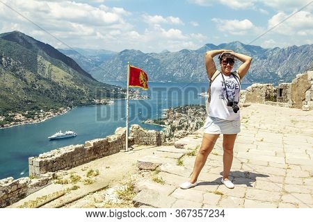 Kotor.montenegro.june 5, 2015.a Girl On The High Platform Of The Kotor Fortress In Montenegro On A S