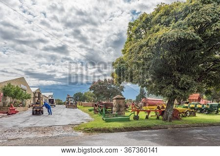 Ficksburg, South Africa - March 20, 2020: A Street Scene, With Agriculture Equipment, People And Veh