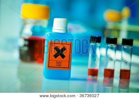 Dangerous substance in a plastic container on laboratory table