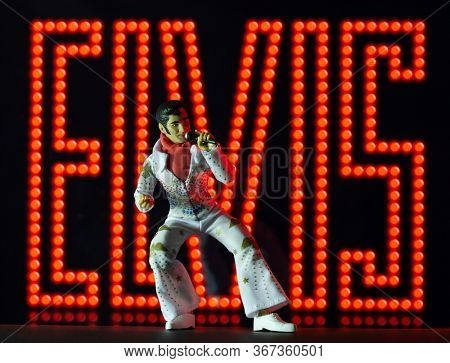 MAY 13 2020: Elvis Presley action figure against a neon background - Mego Corporation action figure