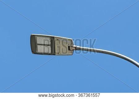 Led Streetlight Against Clear Blue Sky Background. Modern Energy-saving Technologies For Lighting St