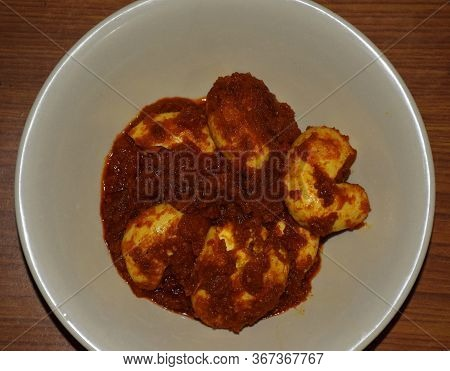Indian Bengali Egg Masala Curry Also Known As Dimer Curry In Bengali Language. Top Angle Shot