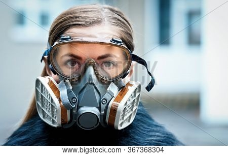 Young Woman Wearing Full Face Respirator Protective Mask And Goggles, Extreme Coronavirus Protection
