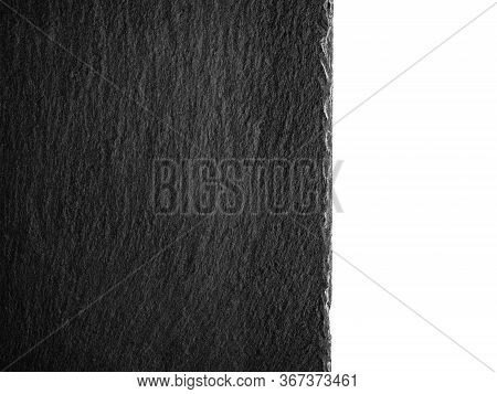Black Slate Plate Fragment. Black Stone Slate Board. Top View Of An Empty Slate Surface Isolated On