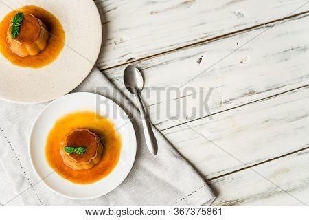 Close Up Of A Flan Creme Caramel Pudding With Mint, A Custard Dessert.