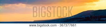 Golden Sunset Over The Mountains Silhouette Of A Mountain Range Against The Sky At Sunset Panorama