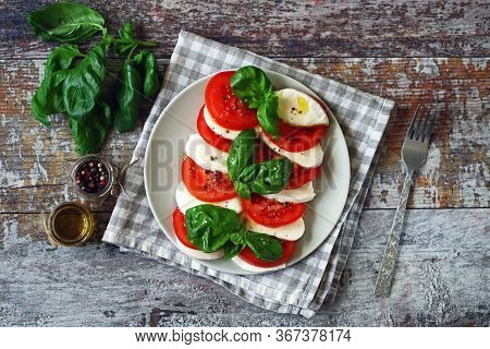 Traditional Caprese Salad With Tomato Mozzarella And Basil. Healthy Salad. Diet Food.