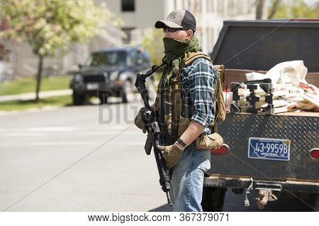 Helena, Montana - May 20, 2020: An Armed Man, Militia Member, Protest At The Capitol Building, Holdi