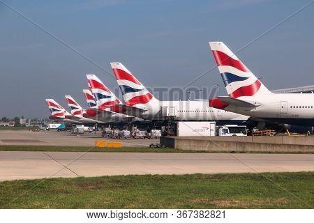 London, Uk - April 16, 2014: British Airways Boeing 777s At London Heathrow Airport. Ba Operates Fle