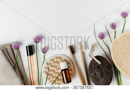 Face And Body Sponges, Bamboo Toothbrushes, Perfume And Pumice On White Background. Daily Routine Co