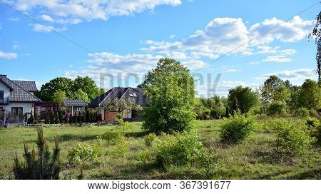 View Of  House In Suburban Neighborhood. Suburban Landscape.
